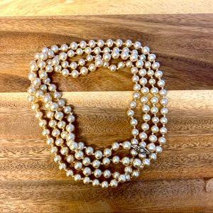 "Vintage 30"" champagne pearl strand"